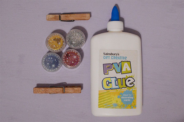 PVA glue, wooden pegs and glitter